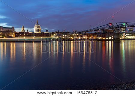 LONDON, ENGLAND - JUNE 18 2016: Night photo of Millennium Bridge, Thames River and  St. Paul Cathedral, London, Great Britain