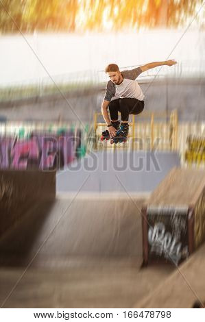 Rollerblader is jumping. Roller skater on blurred background. Defy the laws of gravity.