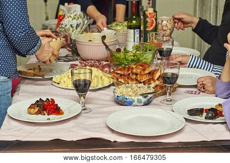 People celebrate holidays at  home festive table