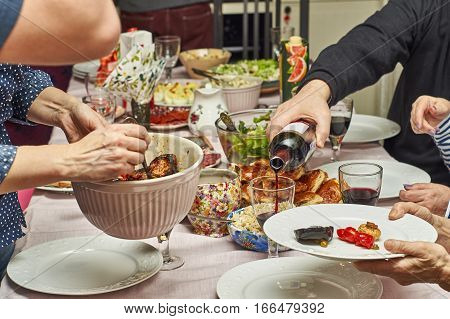 Family celebrates New Year at home festive table