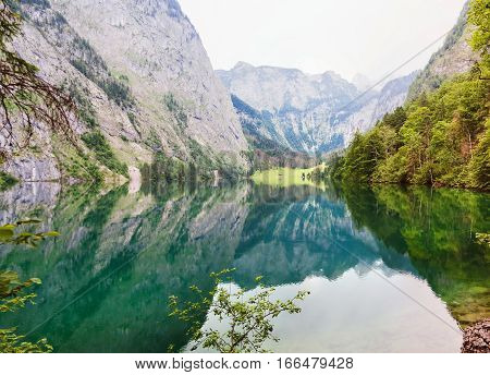 Panoramic view of Obersee lake with clear green water and reflection Konigssee National Park Berchtesgaden Bavaria Germany