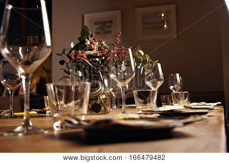 Close focus view on row of empty water and wine transparent glasses on served for holiday dinner table