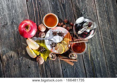 Traditional Scandinavian drink. Hot wine tea honey and lemon. Top view.