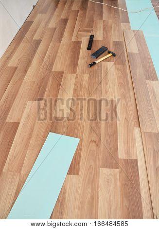 Installing wooden laminate flooring. Laminate flooring tools.