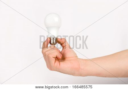 man's hand holding the LED lamp on a white background