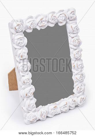 Decorativegypsum photo frame with roses flovers isolated on white background.