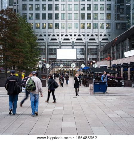 LONDON UK - 23 OCTOBER 2012: Business professionals milling around the base of Canary Wharf in London's business district Docklands.