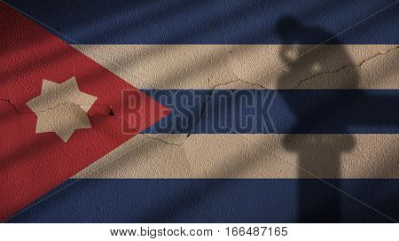 Thinker Shadow on Cuba Flag and Cracked Concrete Wall