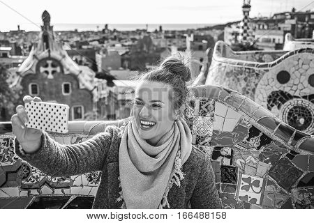 Traveller Woman At Guell Park Taking Selfie With Mobile Phone