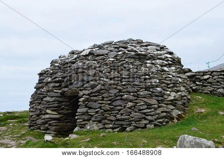 Dry stone beehive hut on the Dingle Penninsula in Ireland.