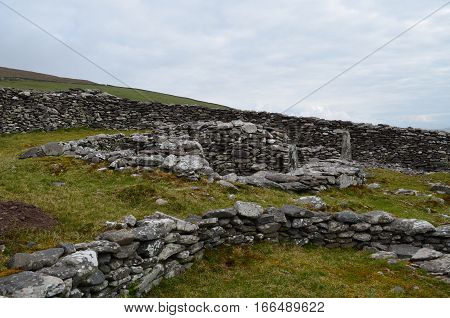 Great collection of ruins of the ancient stone beehive huts.