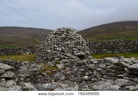 Ruins of the stone beehive huts found in Ireland.