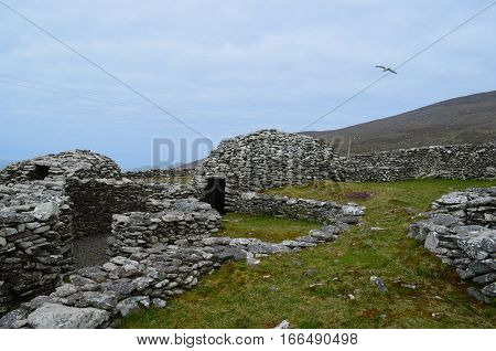 Collection of dry stone beehive huts almost fully intact on the Dingle Penninsula.