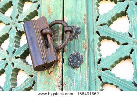 Ancient Asian Temple Ring Shaped Door Handle on Hardwood Doorframe