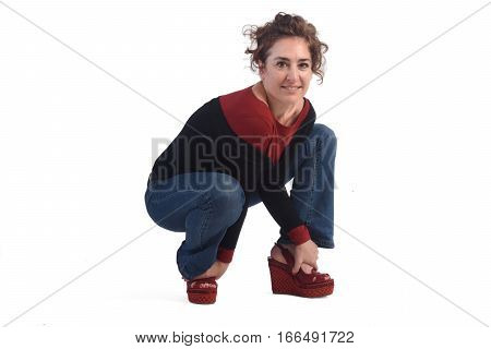 a Woman crouching on a white background