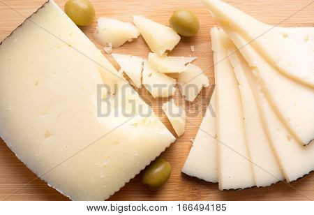 Top View Of Manchego Cheese On Wooden Board