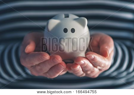 Woman with piggy coin bank home budget finance and savings concept
