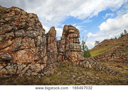 Unusual natural textured rock formations on sky background horizontal