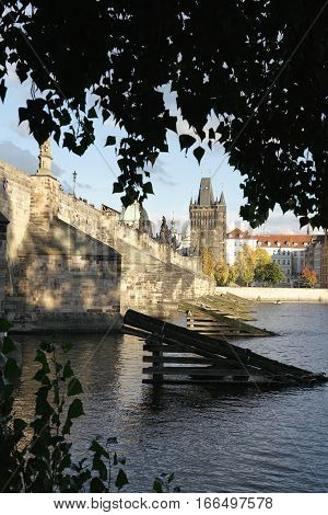 PRAGUE, CZECH REPUBLIK - OCTOBER 20, 2016: historic Charles Bridge over the Vltava river in Prague. The Charles Bridge is one of the main attractions of the city