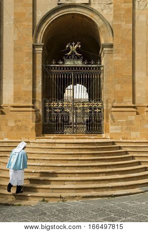 Enna, Sicily, Italy - March 25, 2016. Door Of The Cathedral With A Man Dressed For The Procession On