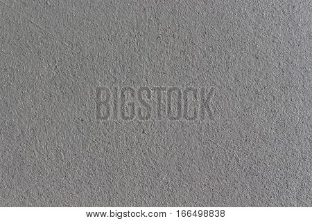 counstructed wet grey rough plaster walls background