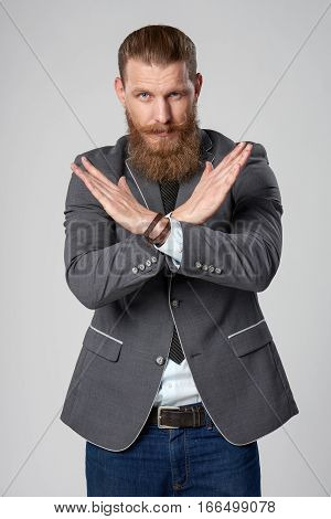 Serious hipster business man gesturing enough denial sign