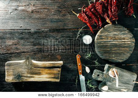 Spices and potherbs for cooking. Wooden cutting boards variety