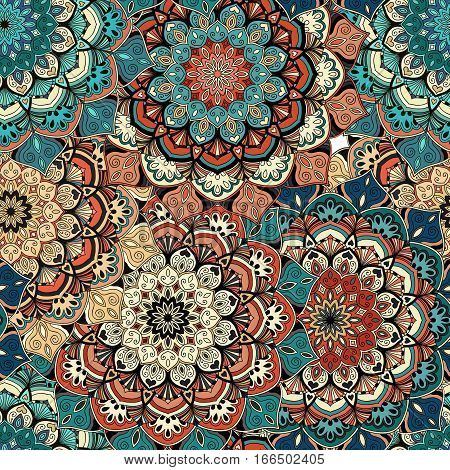 Flower Seamless Pattern. Brown blue background. Intricate vintage design. Stylized mandala elements. Boho decorative ornament. Complex interior fabric print, wallpaper, floor. Vector illustration.
