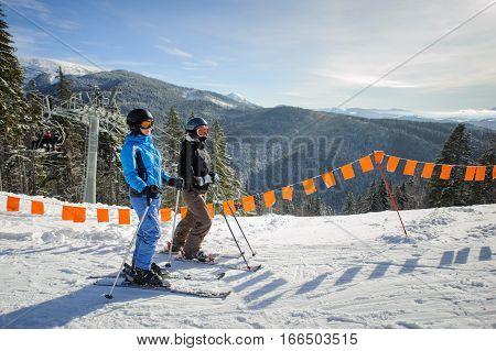 Young Couple Of Women Enjoying Skiing At Ski Resort