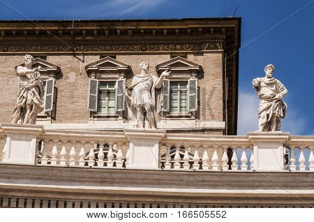 a group of saint statues on the Bernini Columnate in St. Peter' Square