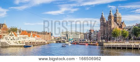 AMSTERDAM, NETHERLANDS - SEPTEMBER 18, 2016: Panorama of the St. Nicolas Church in the center of Amsterdam, Holland