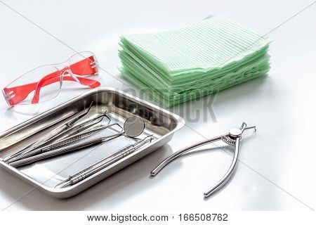 dentists tools in cabinet on white desktop close up