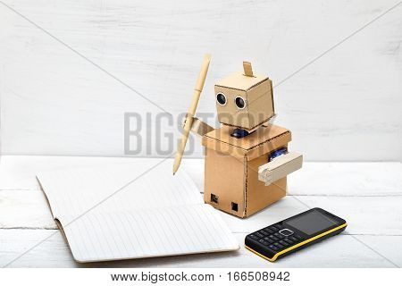 The robot holds the handle of kraft paper and wrote in diaries. Artificial Intelligence