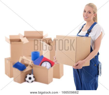 Moving Day Concept - Woman In Blue Workwear With Cardboard Boxes Isolated On White