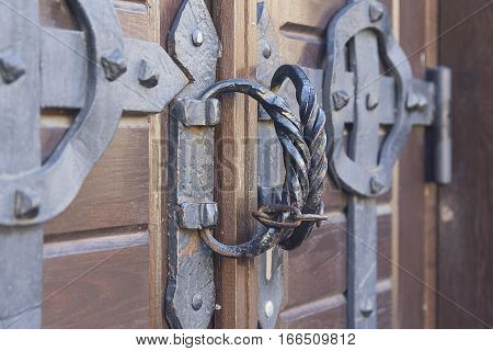Steel handles on ancient wooden gate of church