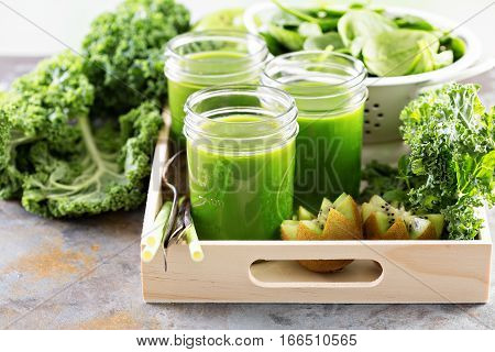 Healthy green kale and fruit juice in mason jars