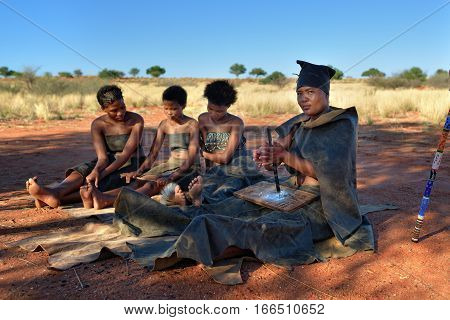 KALAHARI NAMIBIA - JAN 24 2016: Women in bushmen tribe village. The San people also known as Bushmen are members of various indigenous hunter-gatherer peoples of Southern Africa