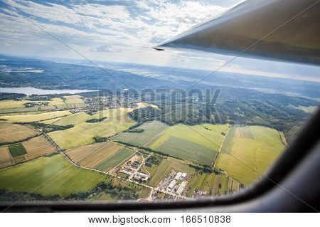 Plane flying over countryside, view from cockpit flying glider
