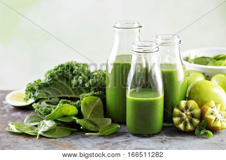 Healthy green kale and spinach juice in glass bottles
