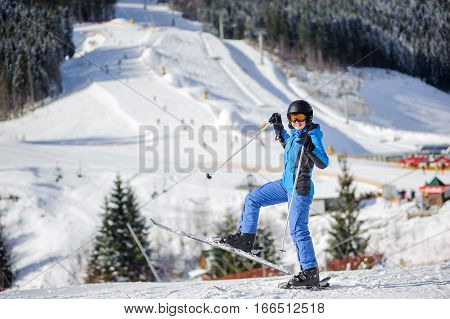 Female Skier On A Ski Slope At A Sunny Day