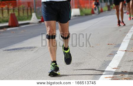 Athletic Runner With The Elastic Band While Running