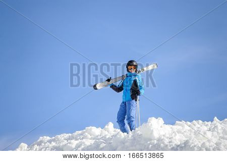 Woman Skier On Top Of The Mountain. Winter Sports Concept
