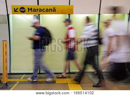 RIO DE JANEIRO BRAZIL - 26 JUNE 2014: Long exposure with deliberate motion blur on soccer fans making their way on the subway to the Maracana football stadium in Rio.