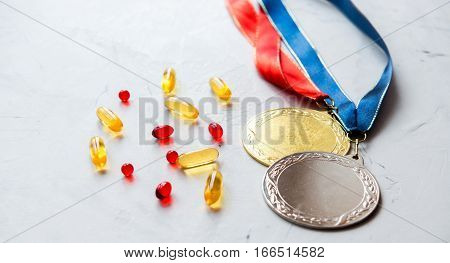 Concept of doping in sport - deprivation medals close up