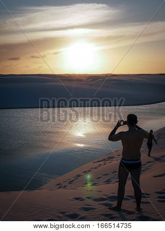 Sunset Over The Dunes And Lagoons Of The Lencois Maranhehses National Park, Maranhao, Brazil