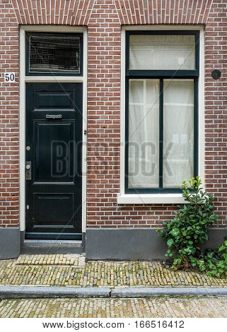 HAARLEM NETHERLANDS - 26 AUGUST 2014: A typical narrow house facade in a side street of Haarlem Netherlands.