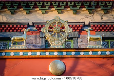 Dharmacakra - Wheel of the Dharma and two doe simbol of buddhism hinduism jainism. Datsan Gunzechoinei large Buddhist temple.