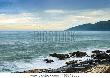 Sun Rise With Water Sea Waves Splashing On Sea Rocks