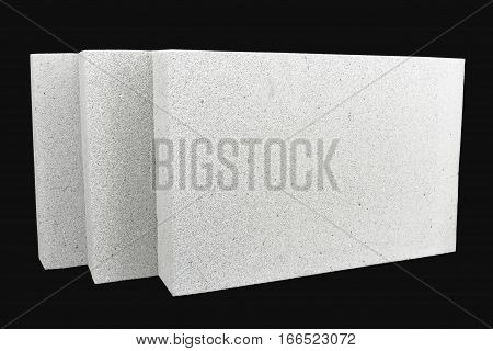 Lightweight foamed gypsum block isolated on black.