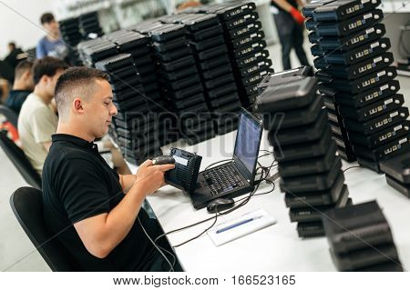 Worker using barcode reader to identify product